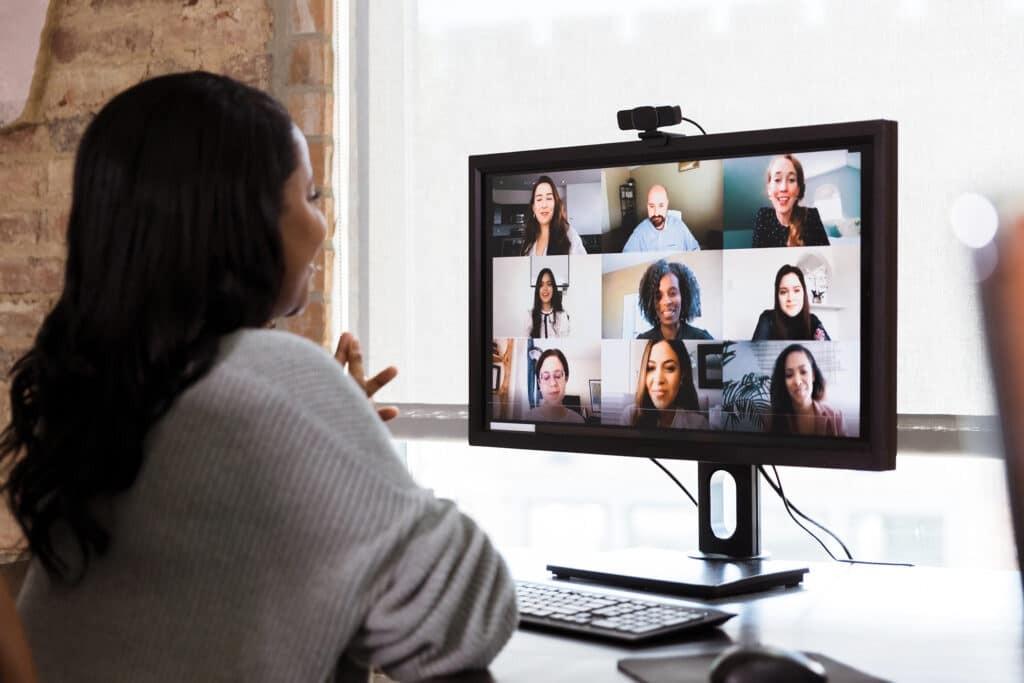 Multi-ethnic team has meeting via video conference
